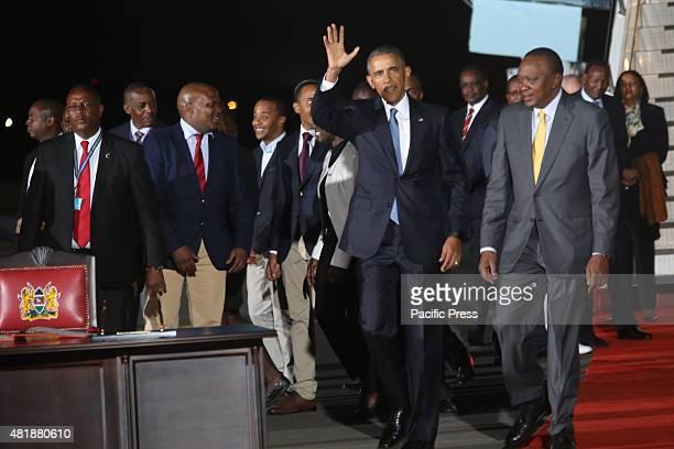 President Barack Obama accompanied by Kenyan President Uhuru Kenyatta waves as he arrives at Jomo Kenyatta International Airport in Nairobi Kenya...