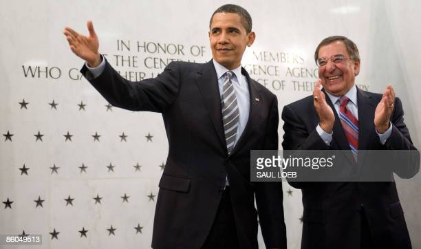 US President Barack Obama acknowledges CIA employees prior to speaking alongside Central Intelligence Agency director Leon Panetta during a visit to...