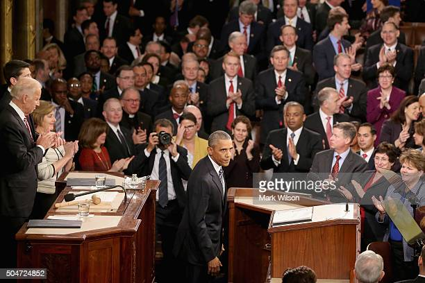 President Barack Obama acknowledges members of Congress after delivering his State of the Union speech in the House chamber of the US Capitol January...