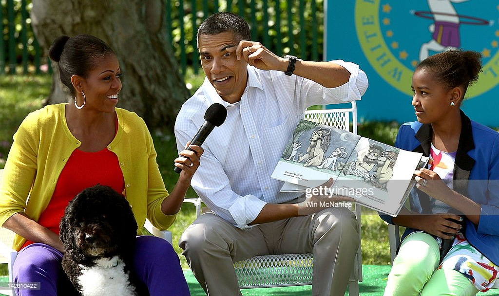 U.S. President Barack Obama acts out a part of the story while reading from the book 'Where The Wild Things Are' with first lady Michelle Obama (L) and his daughter Sasha (R) during the White House Easter Egg Roll on the South Lawn of the White House April 9, 2012 in Washington, DC. Thousands of people people are expected to attend the 134-year-old tradition of rolling colored eggs down the White House lawn that was started by President Rutherford B. Hayes in 1878.