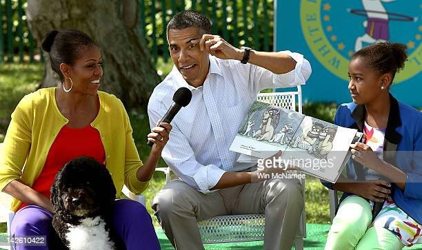 S President Barack Obama acts out a part of the story while reading from the book 'Where The Wild Things Are' with first lady Michelle Obama and his...