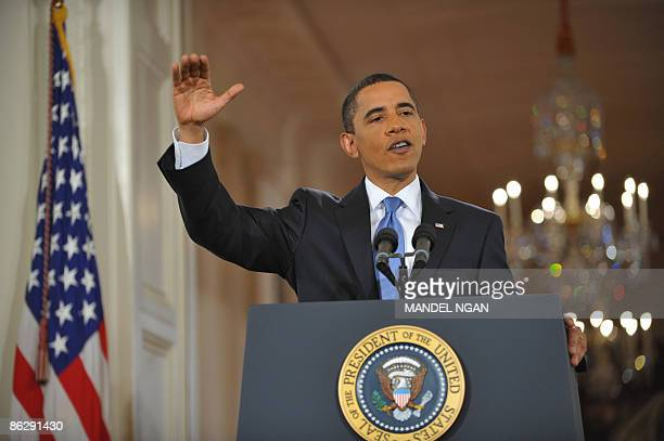 President Barack Obama addresses a prime time press conference on his 100th day in office in the East Room of the White House April 29, 2009 in...