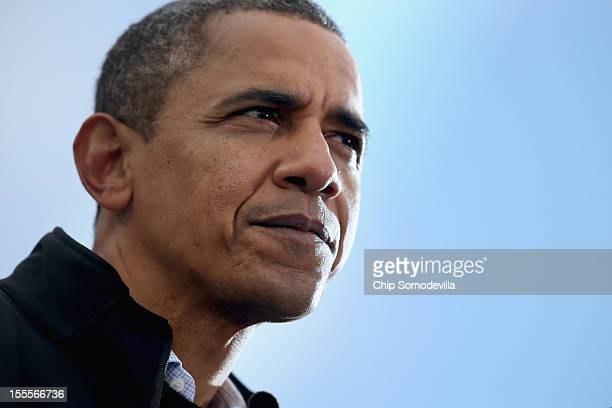 S President Barack Obama addresses a rally during the last day of campaigning in the general election November 5 2012 in Madison Wisconsin Obama and...
