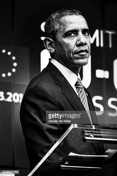 US President Barack Obama addresses the media at the European Council building in Brussels on Wednesday March 26 2014 Black and white picture