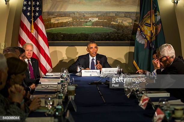 President Barack Obama along with Vice President Joe Biden meets with his National Security Council including FBI Director James Comey Homeland...