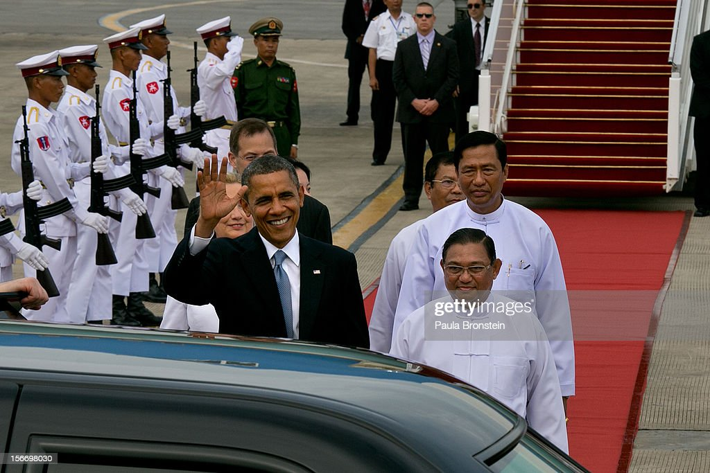 US President Barack Obama alongside Secretary of State Hillary Clinton (L) chat with Burmese Foreign minister Wunna Maung Lwin (R) as they arrive at Yangon International airport during a historical visit to the country on November 19, 2012 in Yangon, Myanmar. Obama is the first US President to visit Myanmar while on a four-day tour of Southeast Asia that also includes Thailand and Cambodia.