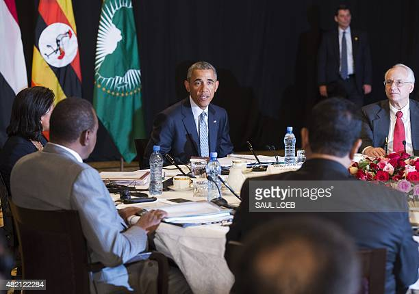 US President Barack Obama alongside US Special Envoy to Sudan and South Sudan Donald Booth speaks during a meeting with representatives from Uganda...