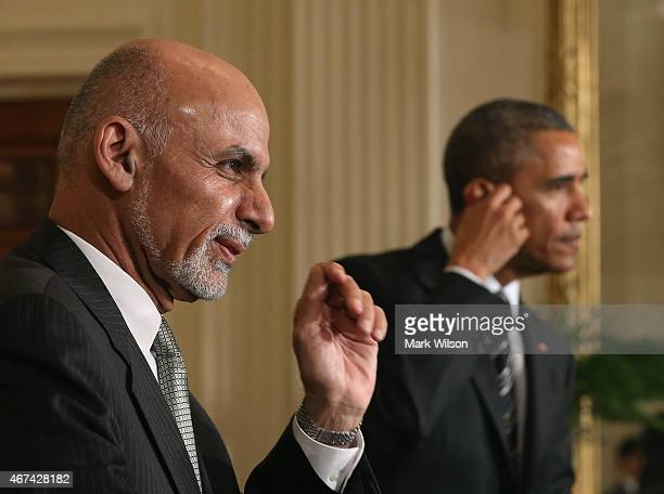 President Barack Obama and Afghan President Ashram Ghani participate in a news conference in the East Room at the White House on March 24, 2015 in...