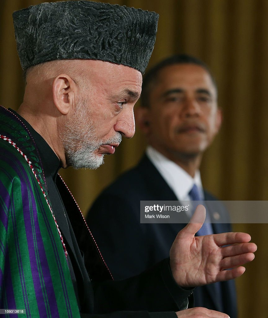 U.S. President Barack Obama (R) and Afghan President Hamid Karzai speak to the media during a joint news conference in the East Room of the White House January 11, 2013 in Washington, DC. Karzai is in Washington for face-to-face meetings with Obama and senior members of his administration about the future of American commitment to Afghanistan and when troops may leave the country after more than 10 years of war.