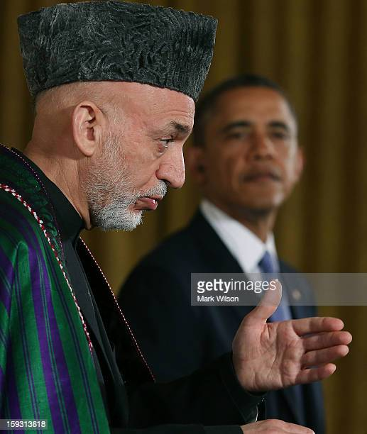 President Barack Obama and Afghan President Hamid Karzai speak to the media during a joint news conference in the East Room of the White House...
