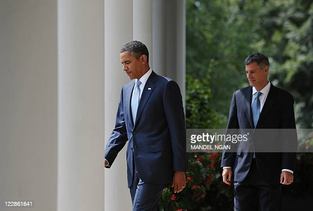US President Barack Obama and Alan Krueger walk through the Colonnade from the Oval Office for a personnel announcement August 29 2011 at the White...