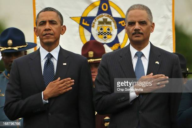 US President Barack Obama and Attorney General Eric Holder attend the National Peace Officers' Memorial Service at the US Capitol May 15 2013 in...