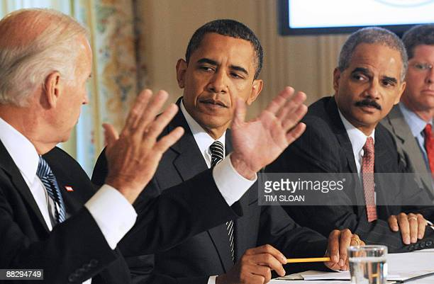 US President Barack Obama and Attorney General Eric Holder listen to remarks by Vice President Joe Biden during a Cabinet meeting to discuss the...