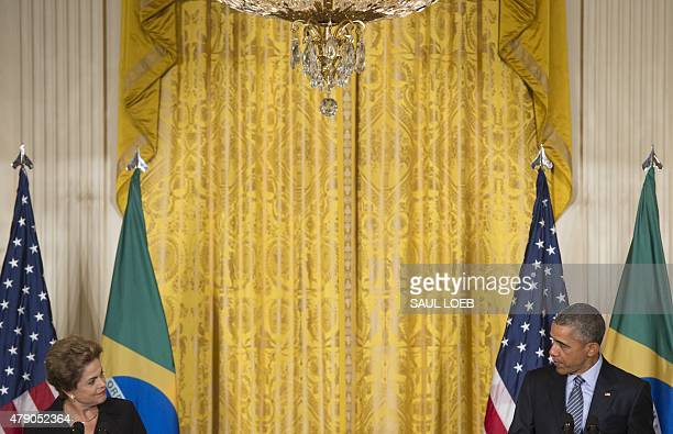 US President Barack Obama and Brazilian President Dilma Rousseff hold a joint press conference in the East Room of the White House in Washington DC...