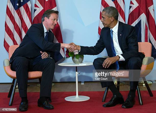 S President Barack Obama and Britain's Prime Minister David Cameron shake hands during a bilateral meeting at the summit of G7 nations at Schloss...
