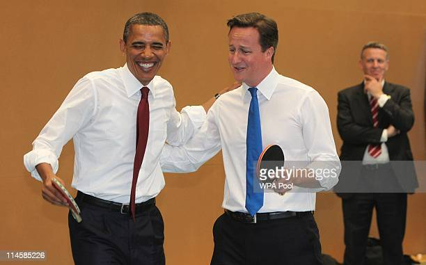 S President Barack Obama and Britain's Prime Minister David Cameron play table tennis at Globe Academy on May 24 2011 in London England The 44th...