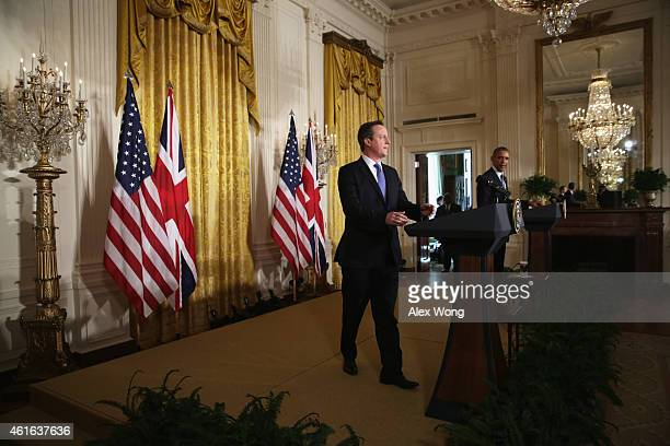 S President Barack Obama and British Prime Minister David Cameron take the podiums for a joint news conference at the East Room of the White House...