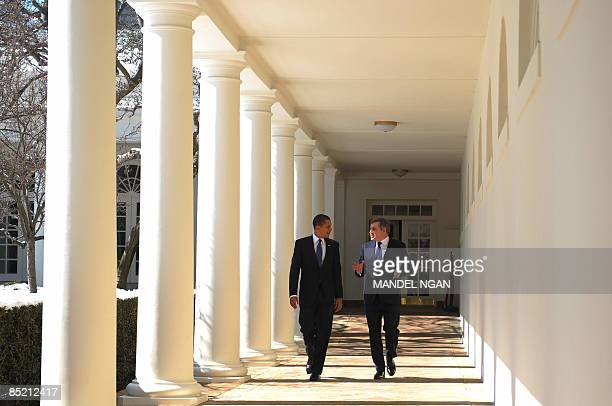 President Barack Obama and British Prime Minister Gordon Brown walk through the Colonnade March 03, 2009 following a meeting in the Oval Office of...