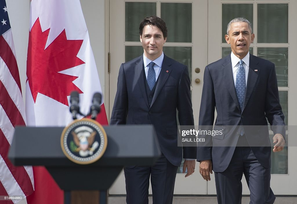 US President Barack Obama and Canadian Prime Minister Justin Trudeau hold a joint press conference in the Rose Garden of the White House in Washington, DC, March 10, 2016, as part of a State Visit. / AFP / SAUL
