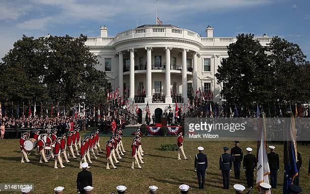 S President Barack Obama and Canadian Prime Minister Justin Trudeau watch as a fife and drum corps performs during a an arrival ceremony on the South...