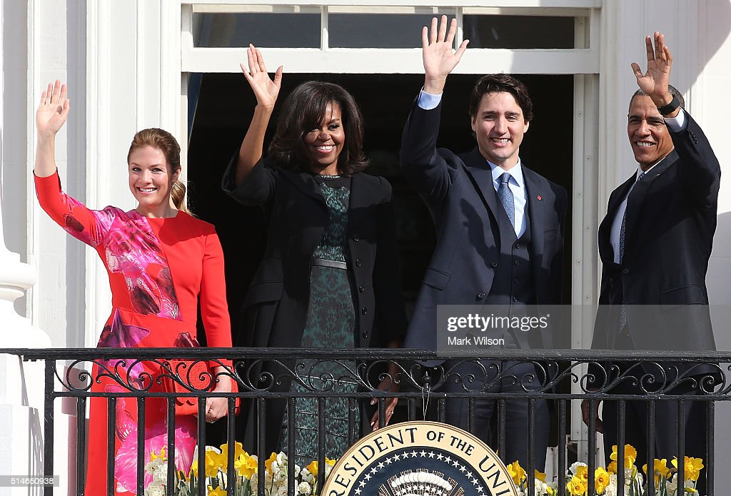 U.S. President Barack Obama (R) and Canadian Prime Minister Justin Trudeau (2nd R), U.S. first lady Michelle Obama (2nd L) and Sophie Grégoire-Trudeau wave to invited guests from the Truman Balcony of the White House after an arrival ceremony at the White House, March 10, 2016 in Washington, DC. This is Trudeau's first trip to Washington since becoming Prime Minister.