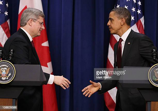 S President Barack Obama and Canadian Prime Minister Stephen Harper shake hands while participating in a joint press availability at the White House...