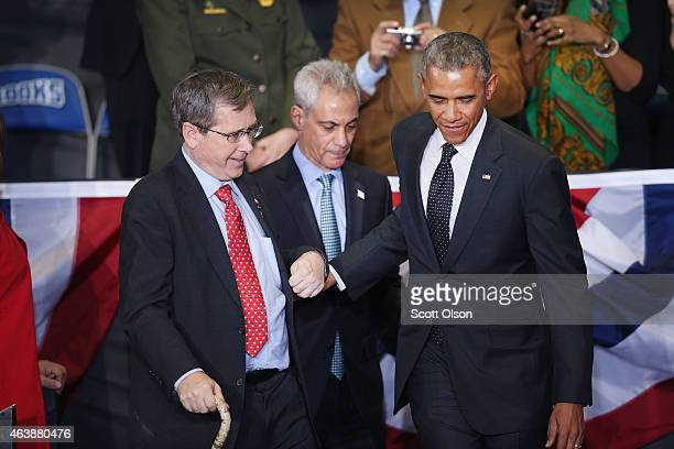 President Barack Obama and Chicago Mayor Rahm Emanuel help Senator Mark Kirk on to the stage before signing a proclamation at the Gwendolyn Brooks...