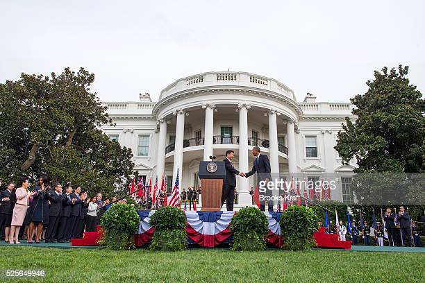 US President Barack Obama and China President Xi Jinping shake hands during an arrival ceremony on the South Lawn at the White House in Washington DC