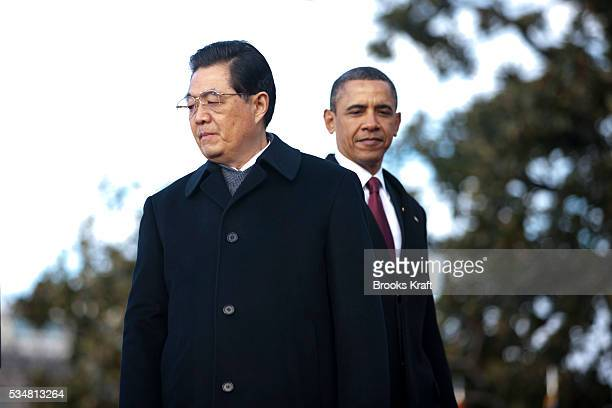 President Barack Obama and Chinese President Hu Jintao attend an official south lawn arrival ceremony for Hu at the White House in Washington.