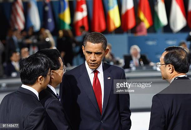 S President Barack Obama and Chinese President Hu Jintao speak at the plenary session of the G20 summit on September 25 2009 in Pittsburgh...