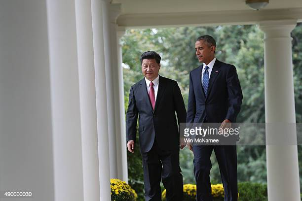 S President Barack Obama and Chinese President Xi Jinping arrive for a joint press conference in the Rose Garden at The White House on September 25...
