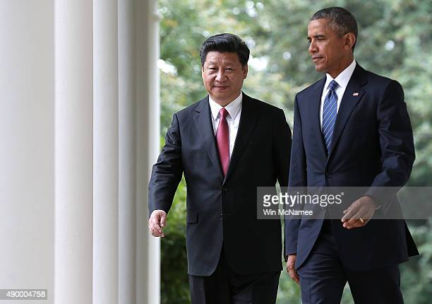 President Barack Obama and Chinese President Xi Jinping arrive for a joint press conference in the Rose Garden at The White House on September 25,...