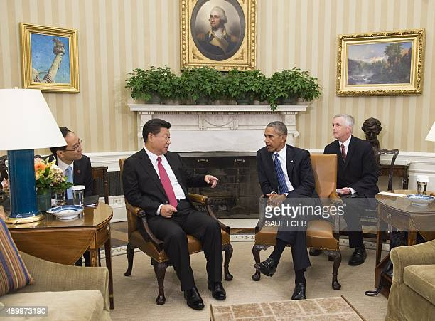 US President Barack Obama and Chinese President Xi Jinping hold a meeting in the Oval Office of the White House in Washington DC September 25 2015...