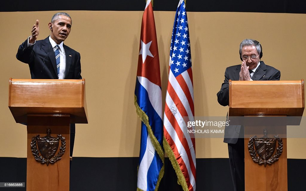 US President Barack Obama (L) and Cuban President Raul Castro give a joint press conference at the Revolution Palace in Havana on March 21, 2016. Cuba's Communist President Raul Castro on Monday stood next to Barack Obama and hailed his opposition to a long-standing economic 'blockade,' but said it would need to end before ties are fully normalized. AFP PHOTO/Nicholas KAMM / AFP / NICHOLAS