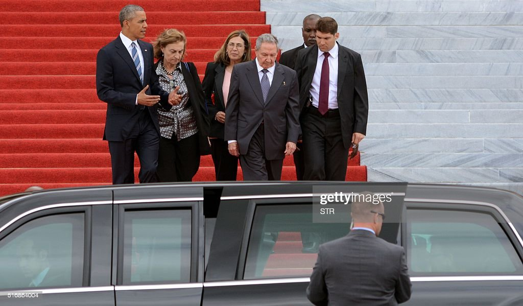 US President Barack Obama (L) and Cuban President Raul Castro (2-R) leave after a meeting at the Revolution Palace in Havana on March 21, 2016. On Monday, Castro stood next to Obama and hailed his opposition to a long-standing economic 'blockade,' but said it would need to end before ties are fully normalized.
