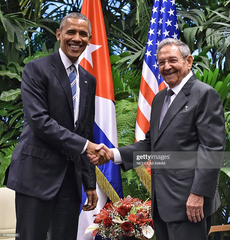 US President Barack Obama (L) and Cuban President Raul Castro shake hands during a meeting at the Revolution Palace in Havana on March 21, 2016. Cuba's Communist President Raul Castro on Monday stood next to Barack Obama and hailed his opposition to a long-standing economic 'blockade,' but said it would need to end before ties are fully normalized. AFP PHOTO/Nicholas KAMM / AFP / NICHOLAS