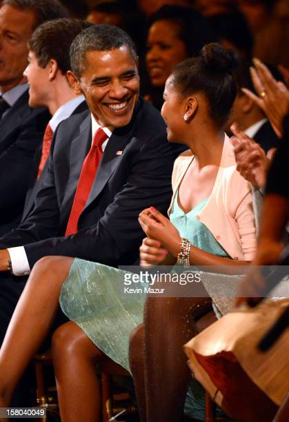 US President Barack Obama and daughter Sasha Obama attend TNT Christmas in Washington 2012 at National Building Museum on December 9 2012 in...