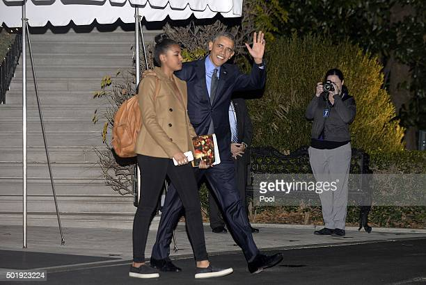 S President Barack Obama and daughter Sasha walk towards Marine One on the South Lawn prior to their departure from the White House December 18 2015...
