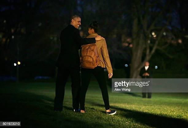 S President Barack Obama and daughter Sasha walk towards the Marine One on the South Lawn prior to their departure from the White House December 18...