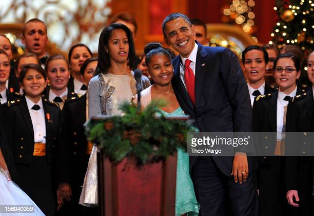 US President Barack Obama and daughters Malia Obama and Sasha Obama onstage during TNT Christmas in Washington 2012 at National Building Museum on...