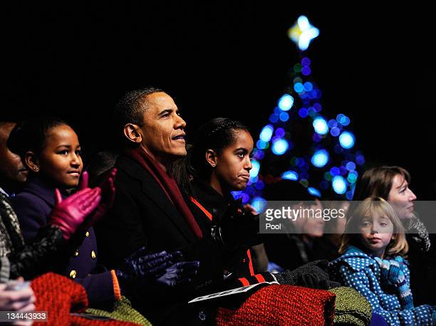 US President Barack Obama and daughters Sasha and Malia participate in the 2011 National Christmas Tree Lighting on December 1 2011 at the Ellipse...