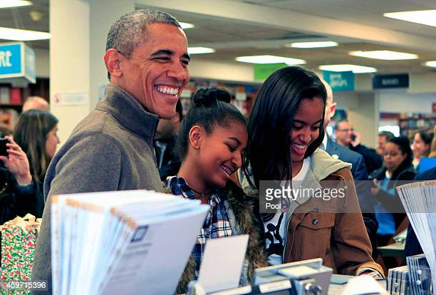 US President Barack Obama and daughters Sasha and Malia purchase books at Politics and Prose bookstore for Small Business Saturday on November 29...