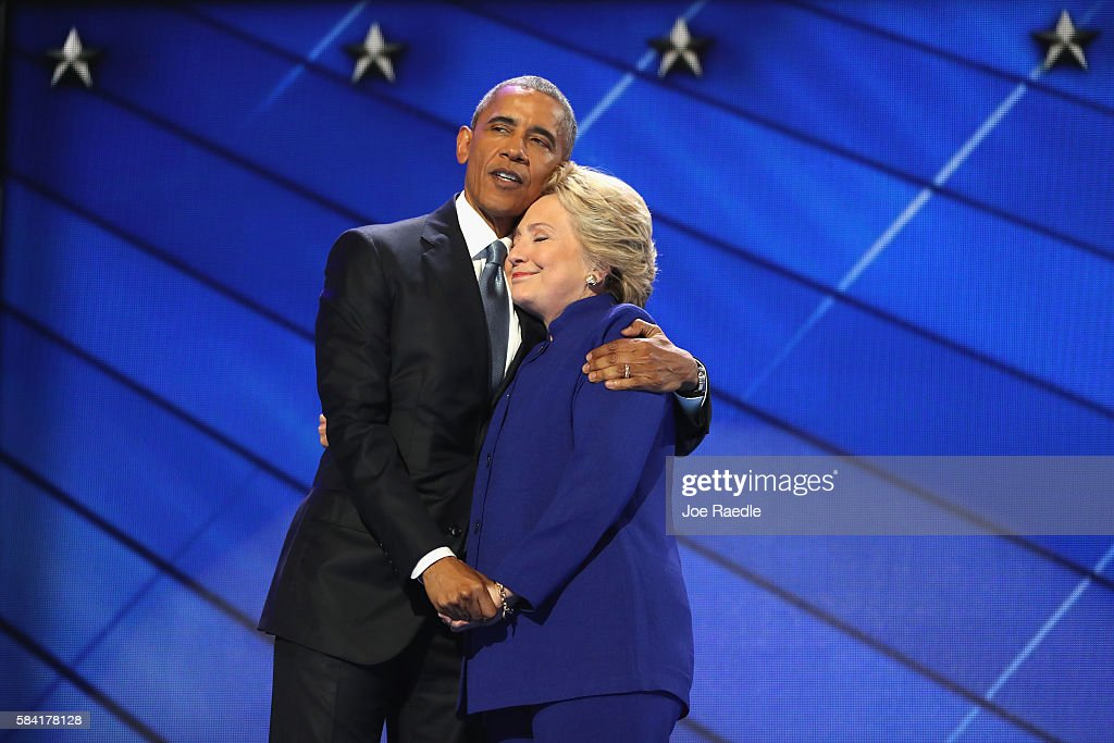 US President Barack Obama and Democratic presidential candidate Hillary Clinton embrace on the third day of the Democratic National Convention at the Wells Fargo Center, July 27, 2016 in Philadelphia, Pennsylvania. Democratic presidential candidate Hillary Clinton received the number of votes needed to secure the party's nomination. An estimated 50,000 people are expected in Philadelphia, including hundreds of protesters and members of the media. The four-day Democratic National Convention kicked off July 25.