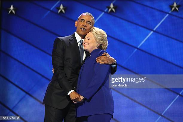 President Barack Obama and Democratic presidential candidate Hillary Clinton embrace on the third day of the Democratic National Convention at the...