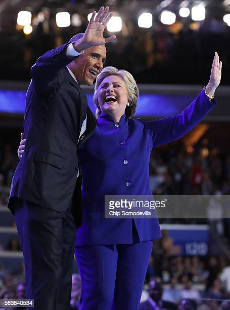 President Barack Obama and Democratic Presidential nominee Hillary Clinton wave to the crowd on the third day of the Democratic National Convention...