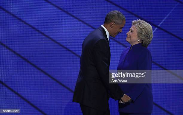 President Barack Obama and Democratic Presidential nominee Hillary Clinton embrace on the third day of the Democratic National Convention at the...