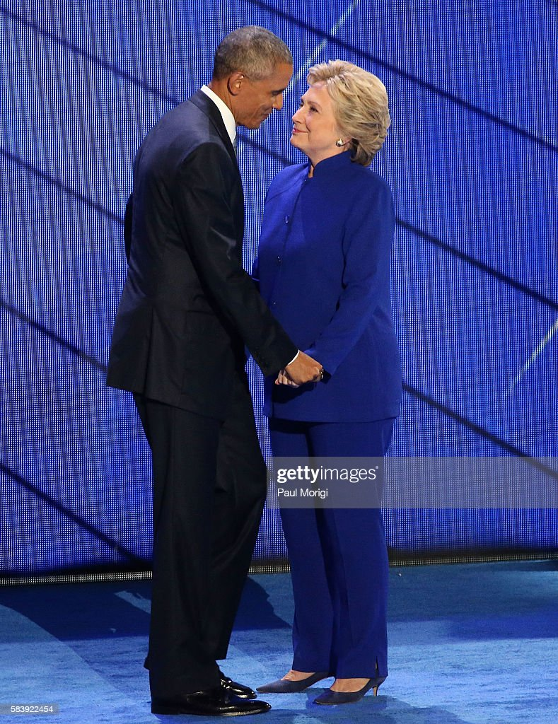 U.S. President Barack Obama and Democratic Presidential nominee Hillary Clinton embrace on the third day of the Democratic National Convention at the Wells Fargo Center on July 27, 2016 in Philadelphia, Pennsylvania. An estimated 50,000 people are expected in Philadelphia, including hundreds of protesters and members of the media. The four-day Democratic National Convention kicked off July 25.