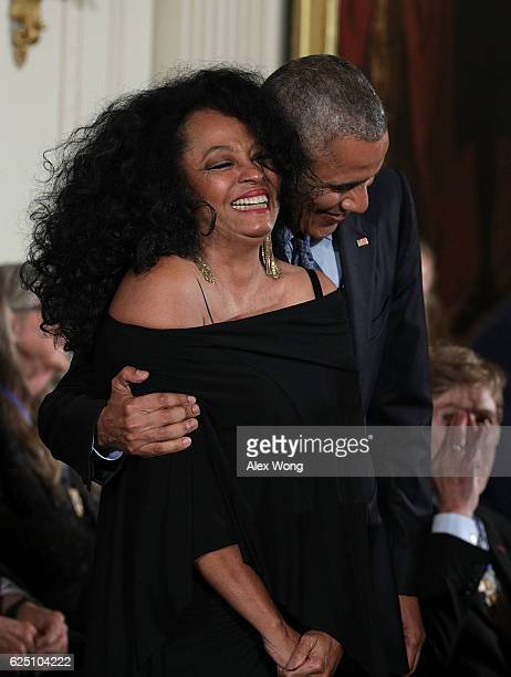 S President Barack Obama and Diana Ross share a moment during a Presidential Medal of Freedom presentation ceremony at the White House November 22...