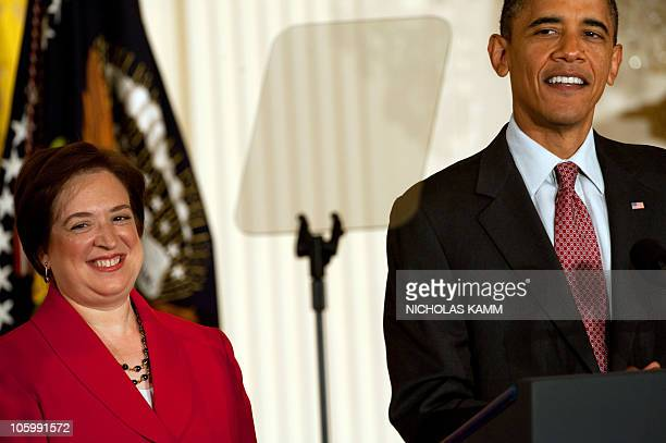 US President Barack Obama and Elena Kagan smile at a reception marking Kagan's confirmation to the Supreme Court in the East Room of the White House...