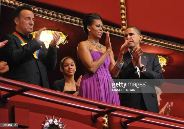 US President Barack Obama and First Lady Michelle Obama applaud with singer and songwriter Bruce Springsteen during the Kennedy Center Honors...
